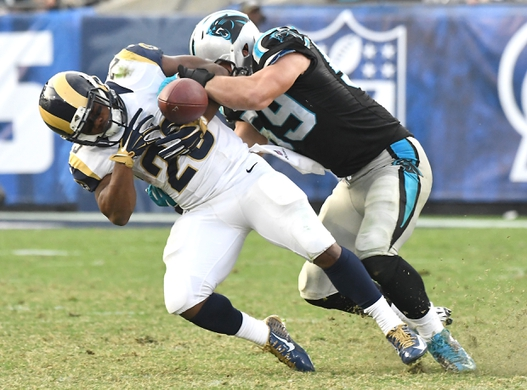 Nov 6, 2016; Los Angeles, CA, USA; Carolina Panthers middle linebacker Luke Kuechly (59) breaks up a pass intended for Los Angeles Rams running back Benny Cunningham (23) in the second half of the game at the Los Angeles Memorial Coliseum. Mandatory Credit: Jayne Kamin-Oncea-USA TODAY Sports