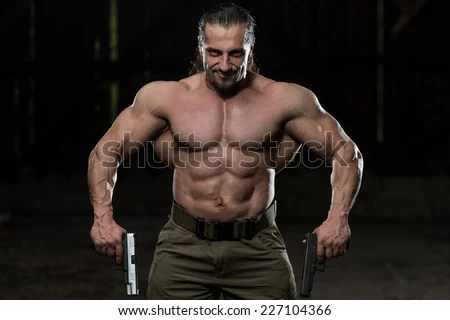Action Hero Muscled Man Holding Two Stock Photo (Royalty ...