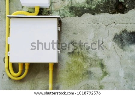 Electrical Panel Yellow Flexible Conduit Wiring Stock Photo  Royalty     Electrical Panel with Yellow Flexible Conduit Wiring on Old Damaged Cement  Plaster Wall