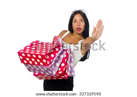 Woman with shopping bags on white - stock photo