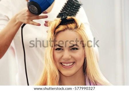 young beautiful blonde woman enjoying hair stock photo shutterstock