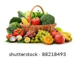 stock photo : Composition with vegetables and fruits in wicker basket isolated on white