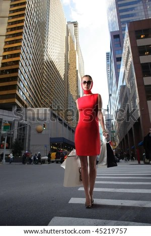 https://i1.wp.com/thumb7.shutterstock.com/display_pic_with_logo/160669/160669,1264332664,1/stock-photo-attractive-girl-in-red-dress-with-shopping-bags-crossing-a-city-street-45219757.jpg