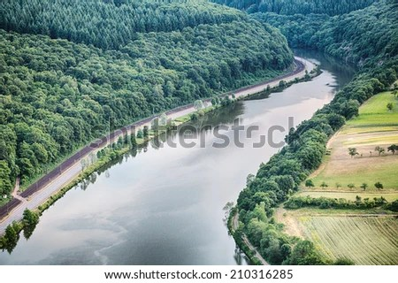 https://i1.wp.com/thumb7.shutterstock.com/display_pic_with_logo/1666885/210316285/stock-photo-the-river-saar-in-germany-passes-along-a-forest-and-farming-fields-210316285.jpg