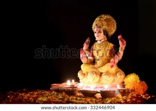 Lakshmi - Hindu goddess, Goddess Lakshmi. Clay diya lamps lit with Goddess Lakshmi during Diwali Celebration. Greetings Card Design Indian Hindu Light Festival called Diwal