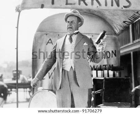 Man selling elixir - stock photo