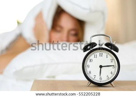 Great Alarm Bedside - stock-photo-alarm-clock-standing-on-bedside-table-going-to-ring-while-woman-cover-head-and-ears-with-pillow-552205228  Photograph_614077.jpg