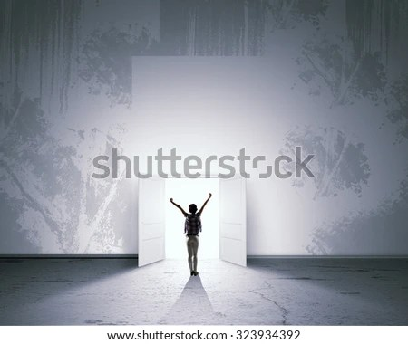 stock-photo-rear-view-of-woman-with-hands-up-entering-opened-door-323934392.jpg (450×380)