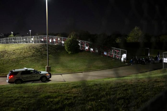 Officers guard the driveway into the jail while demonstrators gather at the Collin County Jail to demand justice for Marvin …