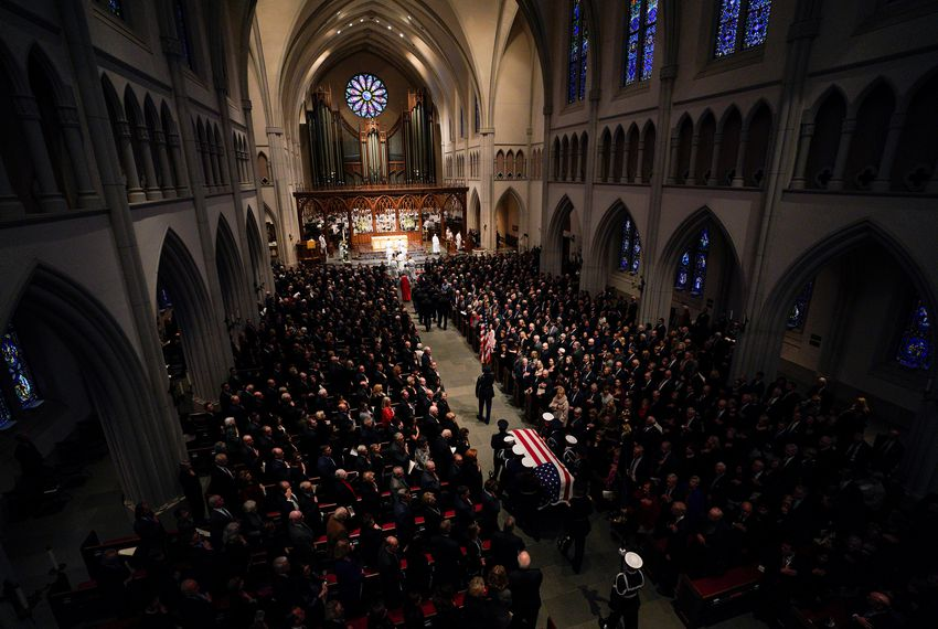 A military honor guard walks the casket into St. Martin's Episcopal Church during the funeral service for former President George H.W. Bush on Dec. 6, 2018 in Houston.