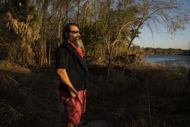 Daniel Villarreal on his property on the Rio Grande in Rio Grande City.. Villarreal says that he sold a portion of his land for the construction of the border wall because he felt pressured to do so and now that Biden won the election he is regretting it.