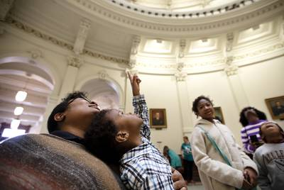 Chyrece Campbell held Pierce Campbell as he looked up at the rotunda at the Capitol. Chyrece and her children, also pictured, Madison, Gregory and Kennedy, visited the building on Jan. 8, the first day of the 86th regular legislative session.