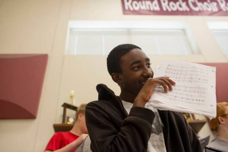 Addison Savors, a junior at Round Rock High school, sings in his choir class on April 26, 2019. The expansion of the marshal program could be triggering for black and brown students.