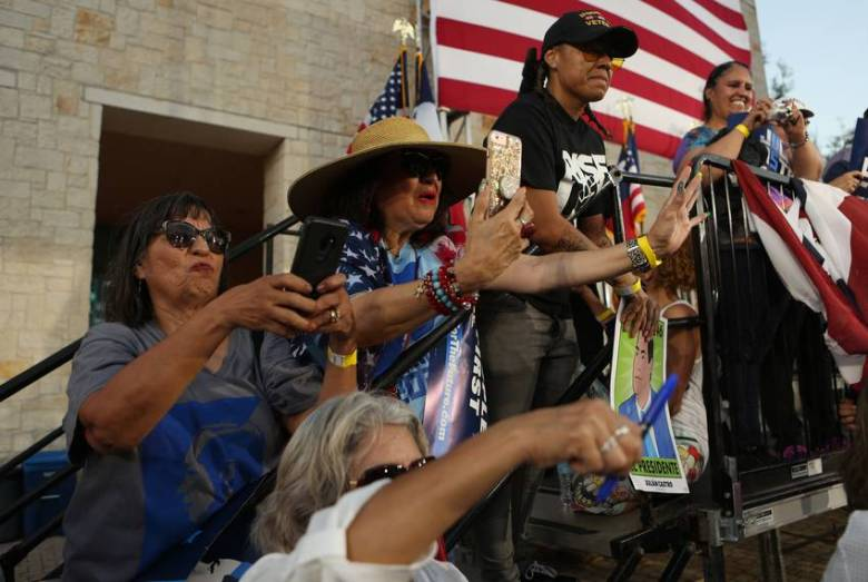Supporters record the event as presidential candidate Julián Castro speaks to at a rally in San Antonio after an earlier visit by President Donald Trump, on April 10, 2019.