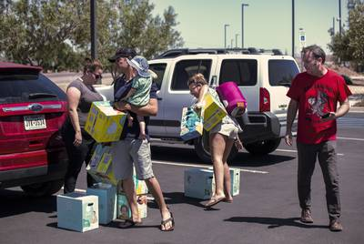 From left: Meagan O'Toole-Pitts, Mark Cortez, holding his son Oliver, Ashley Cortez and Austin Savage attempt to deliver diaper and toys to an immigrant detention center in Clint on June 24, 2019.
