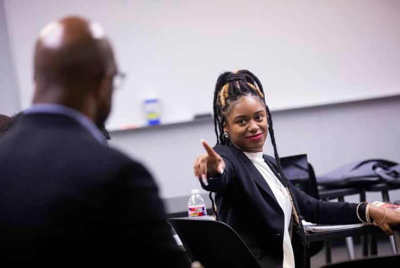 LaMontria Edwards points to challenge President Sorrell's analysis during class discussion.