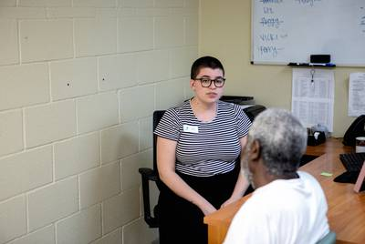 Hope Beaver, a complex needs case manager at Austin Street Center, speaks with a client who needs to visit the Social Security office for a new card, on June 25, 2019.