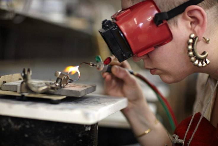 Student Soldering in Jewelry School