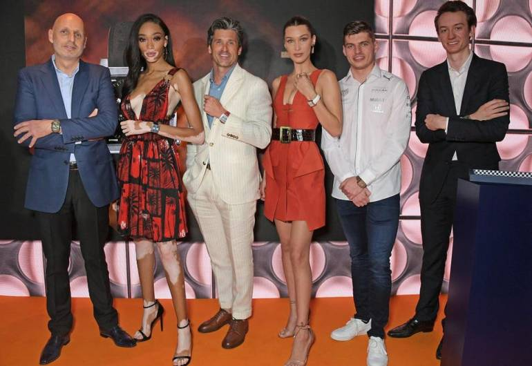 MONACO - MAY 24: (L to R) Stephane Bianchi, CEO of the LVMH Watchmaking Division and CEO of TAG Heuer, Winnie Harlow, Patrick Dempsey, Bella Hadid, Max Verstappen and Frederic Arnault, TAG Heuer Chief Stategy and Digital Officer attend an intimate dinner hosted by TAG Heuer kicking off the Monaco Formula 1 Grand Prix weekend by unveiling the Monaco 1969-1979 Limited Edition.