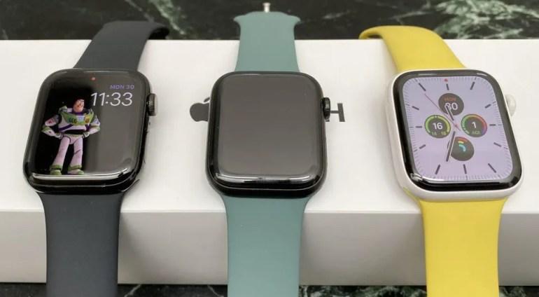 Apple Watch Series 5. Space Black Stainless Steel, Space Black Titanium, Ceramic (L to R)