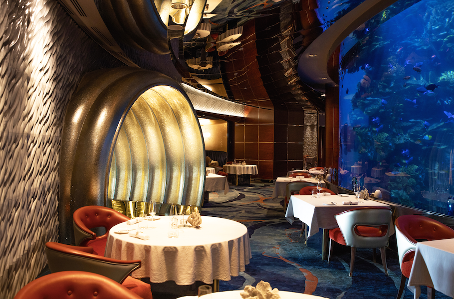 Dine by the floor-to-ceiling aquarium of seafood restaurant Al Mahara.