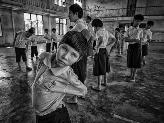 Visually impaired students doing physical exercises in Yangon Blind School in Myanmar. Blind children face many personal hardships through their early developing years. It's a global responsibility to promote the physical and psychological well-being of blind children while enabling them to develop the skills necessary to live safely and happily in our society.