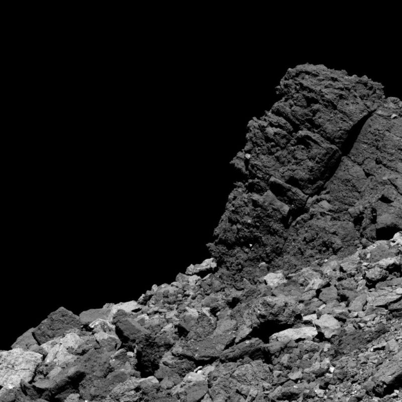Rocky, gray surface of an asteroid.