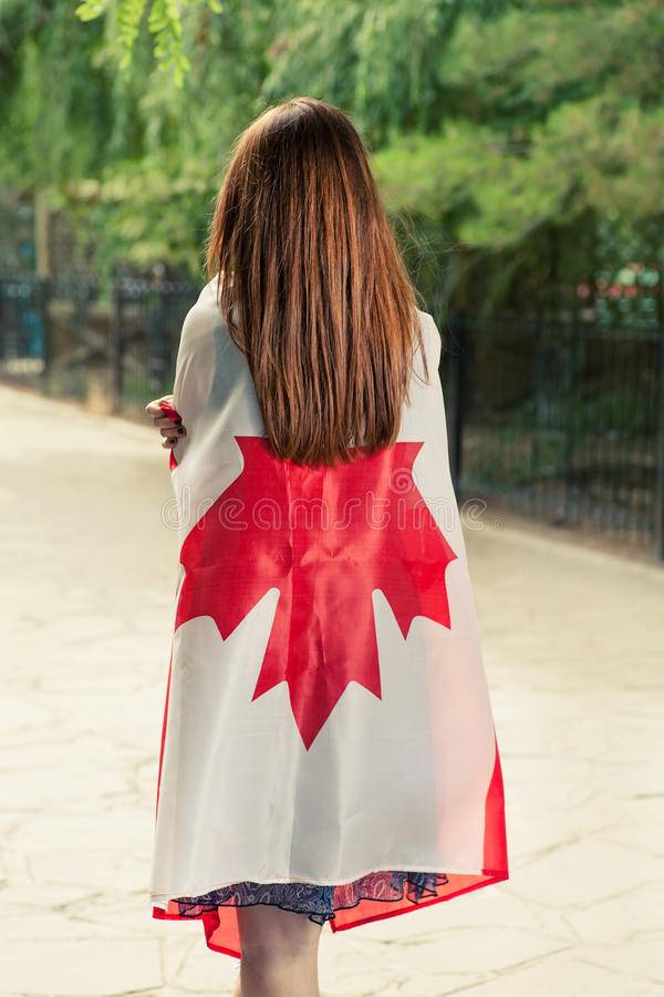 Backside View Of Young Women Wrapped Around With Canada