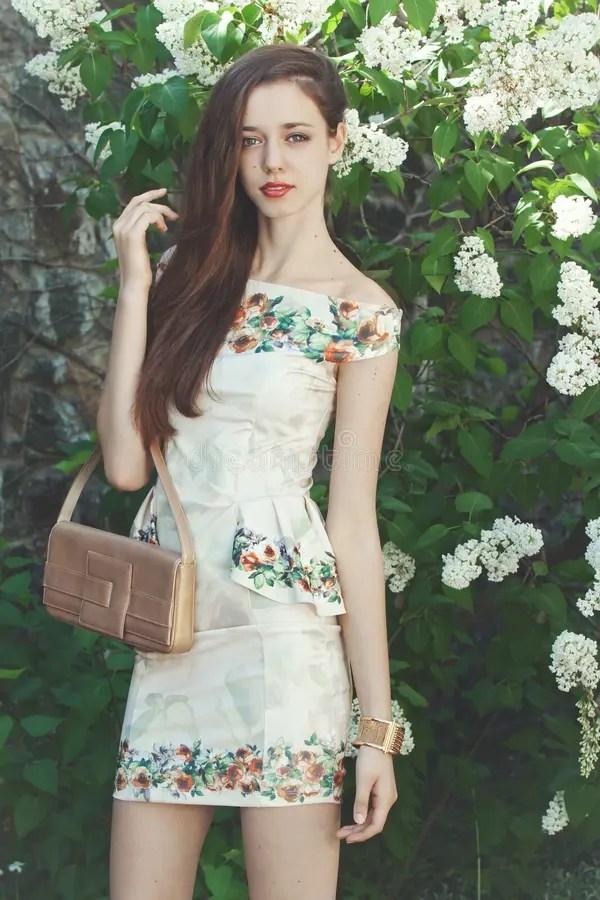 Beautiful Young Girl Model Posing Near Blooming Lilacs At ...