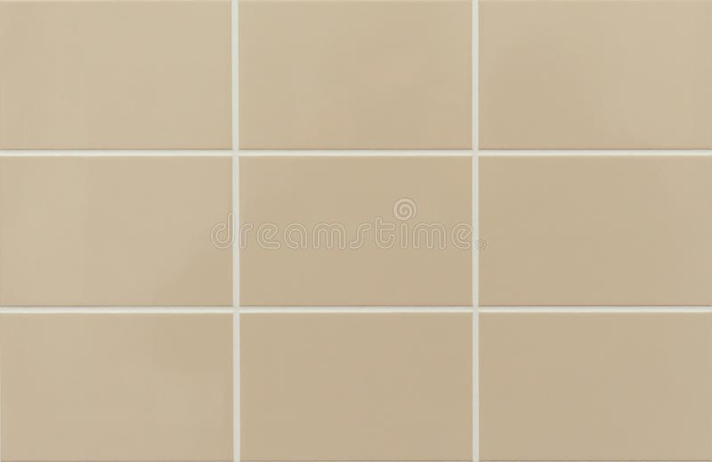 beige ceramic tile on the wall in the