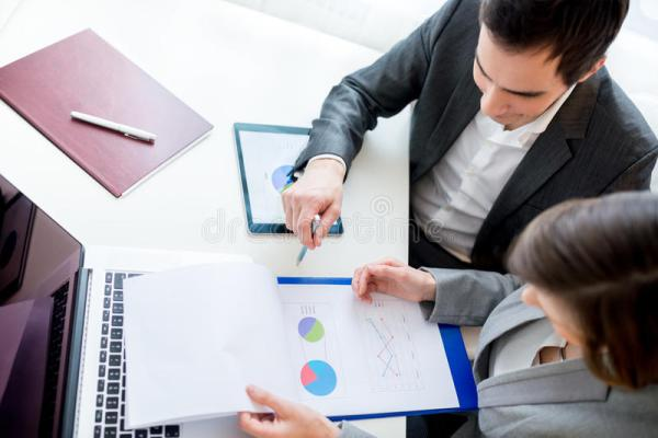 Business People Reviewing Business Documents Stock Photo ...
