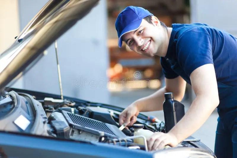 Car Mechanic Working In Auto Repair Service Stock Photo