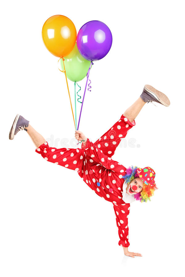 Clown Holding Balloons And Standing On One Hand Stock