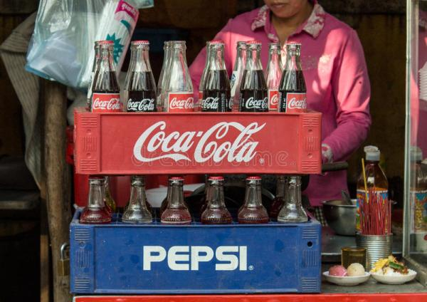 Coca-Cola And Pepsi Bottles Stacked In Plastic Container ...