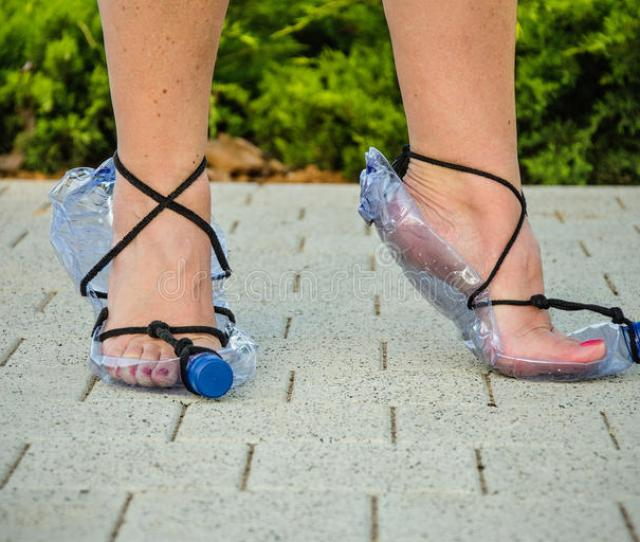Download Economical Wife Showing Homemade Plastic Bottle Sandals Stock Image Image Of Person Paving