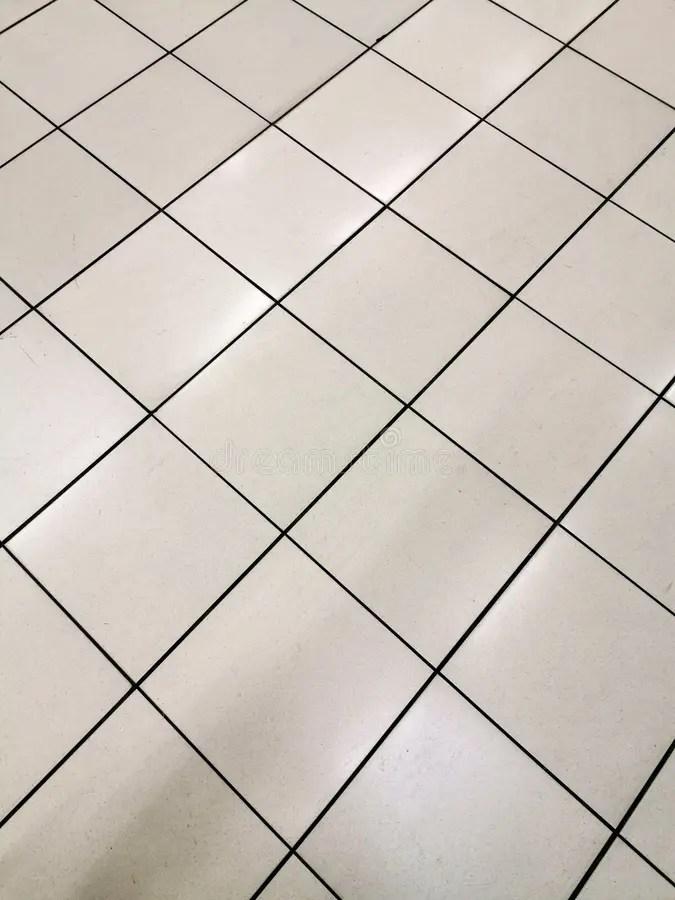 floor with diagonal white tiles stock