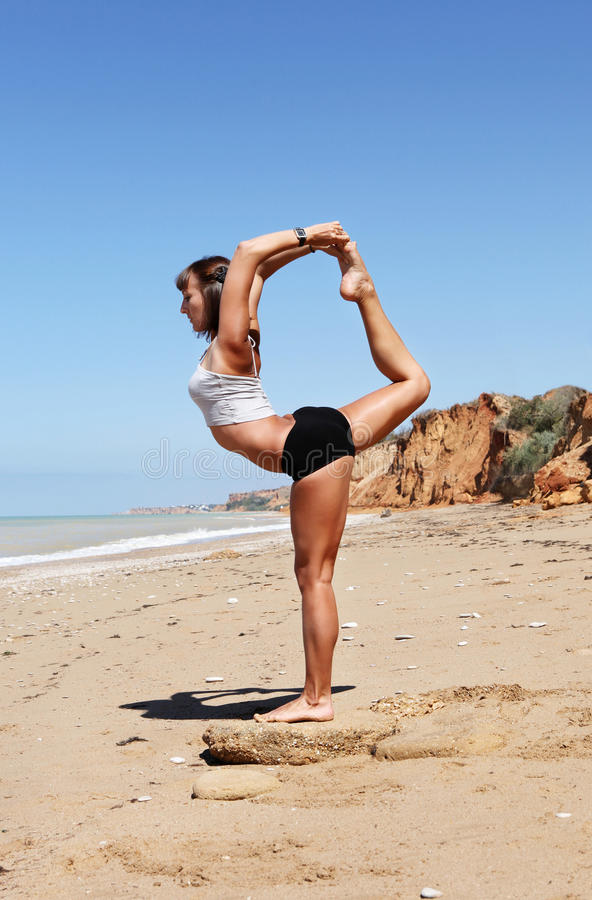 Yoga Practice At The Sea Beach Stock Image - Image of ...