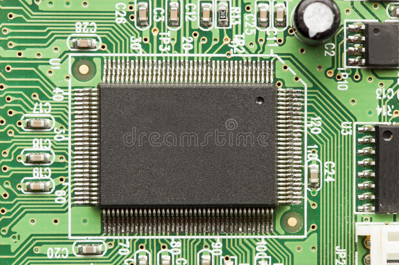 Green Electrical Circuit Board With Microchips And