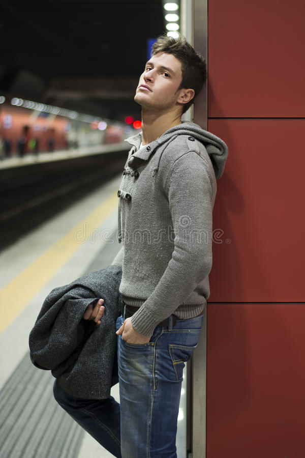 Handsome Young Man Standing Against Wall In Train Or