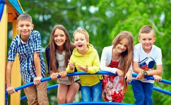 Happy Excited Kids Having Fun Together On Playground Stock ...