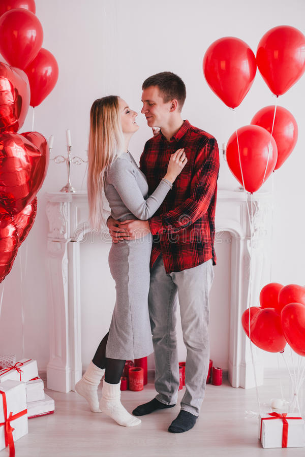 Download Happy Young Couple In Love Posing With Red Heart Balloons ...