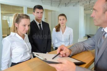 Hospitality manager giving instructions to apprentices. Hospitality manager giving instructions to the apprentices stock image