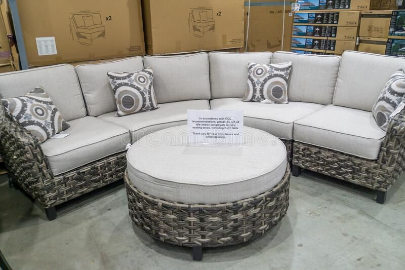 cdc guidelines and recommendations sign for people not to congregate on patio furniture couch section at costco store during covid editorial photography image of editorial indoors 179338777