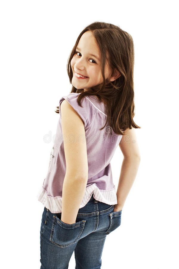 A Little Girl With Hands In Jeans Pockets Stock Photo ...