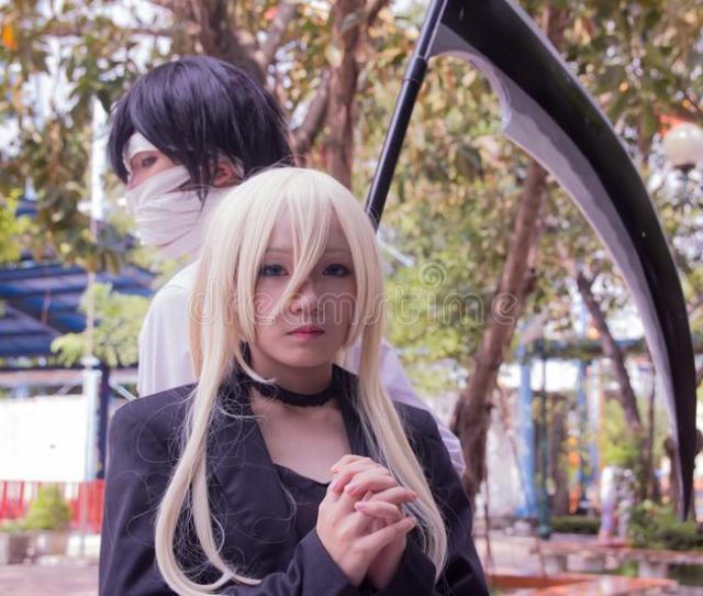 Male And Female Anime Character Cosplay With Scythe Beside Tree Free Public Domain Cc Image