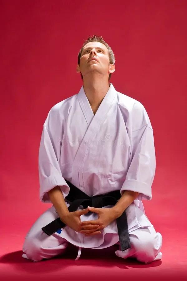 Male Karate Expert Kneeling Stock Photo Image of calmly