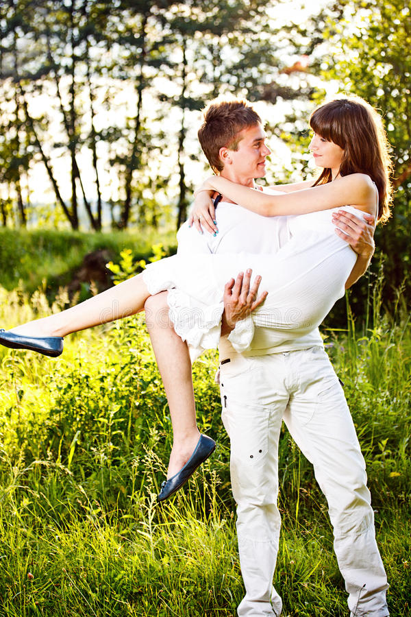 Man Carrying Girlfriend In His Arms Stock Image - Image of ...