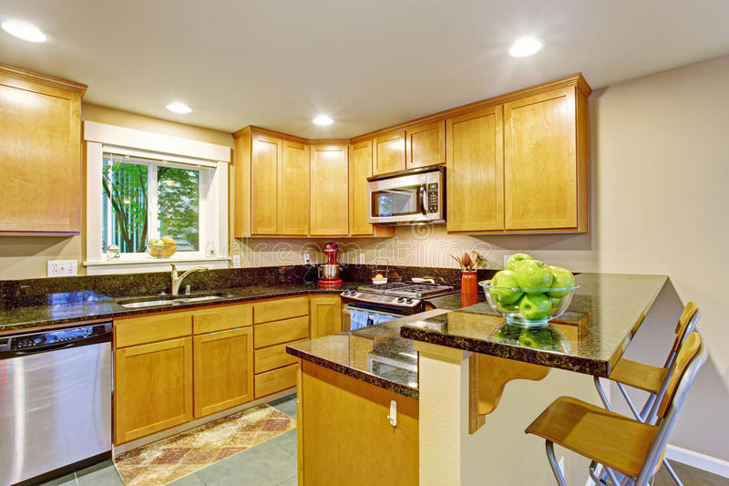 Maple Kitchen Cabinet With Black Granite Tops Stock Image ... on Maple Cabinets With Black Granite Countertops  id=42540