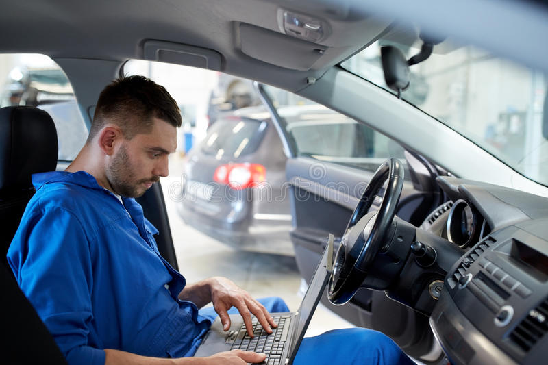 Mechanic Man With Laptop Making Car Diagnostic Stock Photo