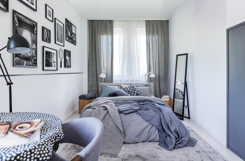 Mirror Next To Bed With Sheets In Bedroom Interior With ... on Mirrors Next To Bed  id=48391
